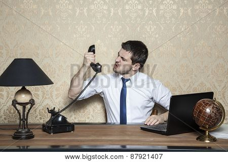 Businessman Screaming To The Handset