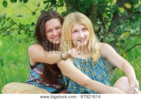 Portrait Of Two Communicating Friends In Summer Garden