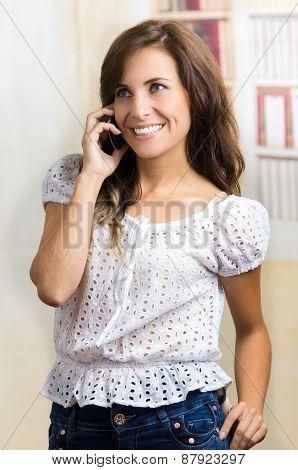 young beautiful hispanic woman using her cell phone