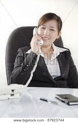 Smiling while talking on the phone