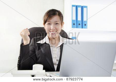 Female executive show success gesturing