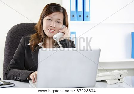 Beautiful young female working in office