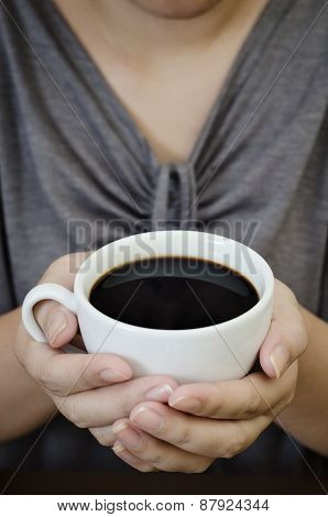 portraiture of a female holding coffee