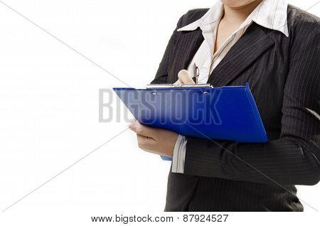 a businesswoman writing on note pad and stand on the right hand side