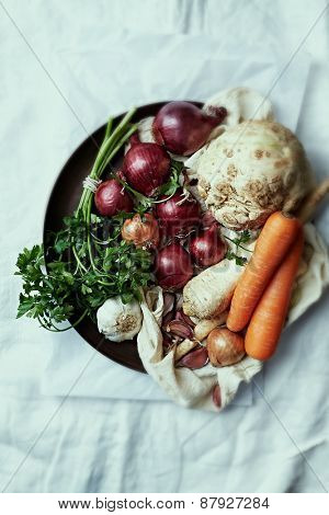 Assorted root vegetables and onions