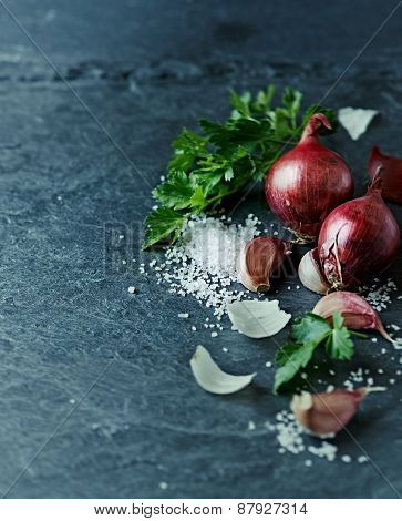 Still life with garlic, onion, parsley and sea salt