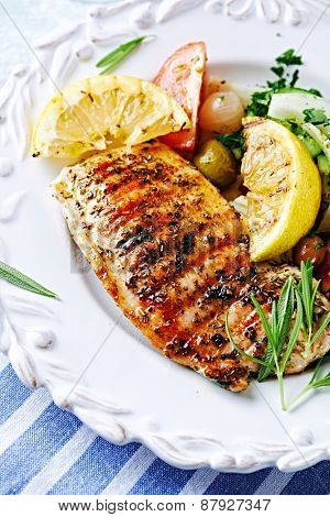 Grilled turkey fillet with grilled lemon and salad
