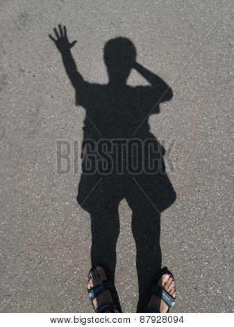 Human Shadow On The Pavement