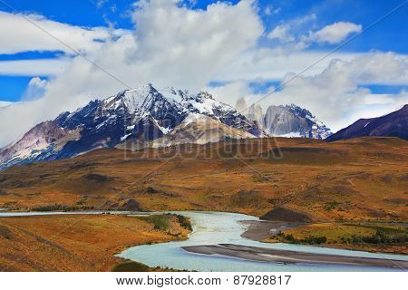 Beautiful Patagonia. Park Torres del Paine in southern Chile. Snow-capped mountains and emerald river