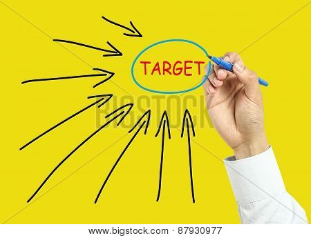 Businessman Hand Drawing Target Concept