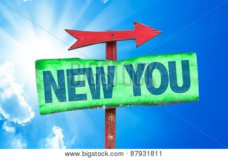 New You sign with sky background