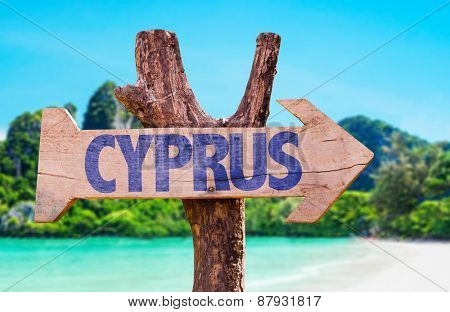 Cyprus wooden sign with beach background