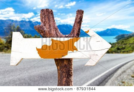 Cyprus Flag wooden sign with road background