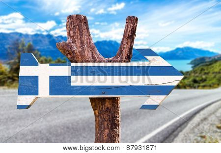 Greece Flag wooden sign with road background