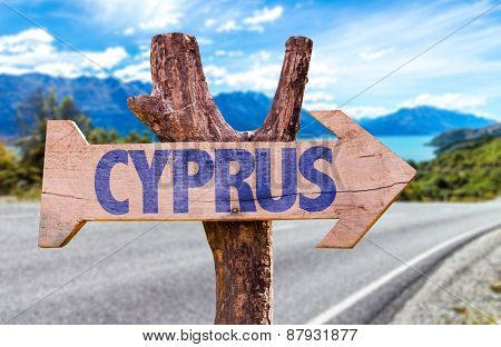 Cyprus wooden sign with road background