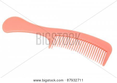 pink comb on a white background