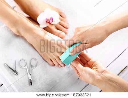 Sawing toenail