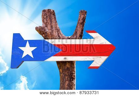 Puerto Rico Flag wooden sign with sky background