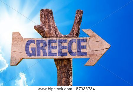 Greece wooden sign with sky background