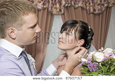 Young married couple posing for the camera indoors