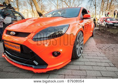 Bright Orange Sporty Styled Ford Focus Car Stands Parked