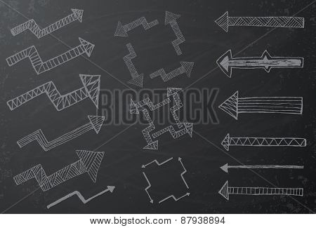 Collection of hand drawn arrows on black chalkboard