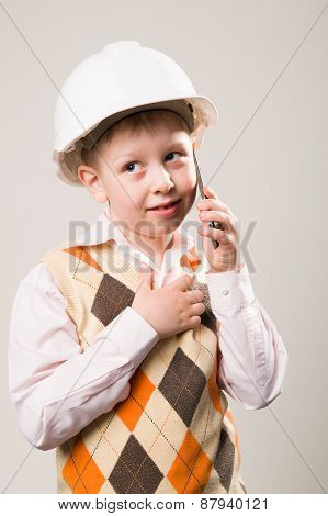 The Boy In The Construction Helmet Talking On The Phone