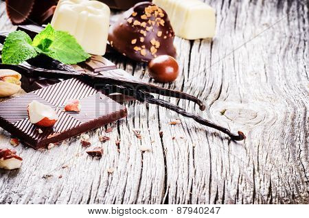 Assortment Of Fine Chocolates And Pralines With Fresh Mint And Vanilla