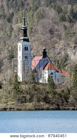 Ancient Church With A High Bell Tower On The Island On Lake Bled