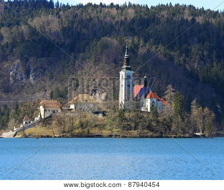 Church With A High Bell Tower On The Island On Lake Bled In Slovenia In Europe