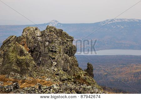 View of the cliff near the mountain lake Zyuratkul