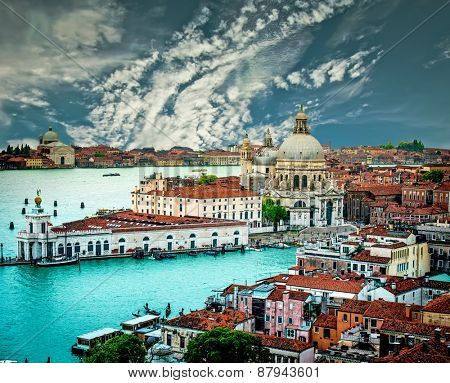 Grand Canal and Basilica Santa Maria della Salute against blue sky, Venice, Italy