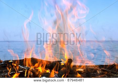 Fire Of Wood With A Sea View