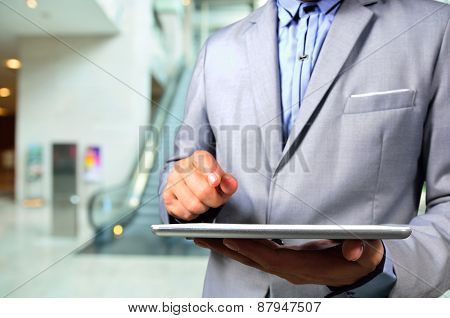 Business Man Using Tablet Pc In Office Building Escalator