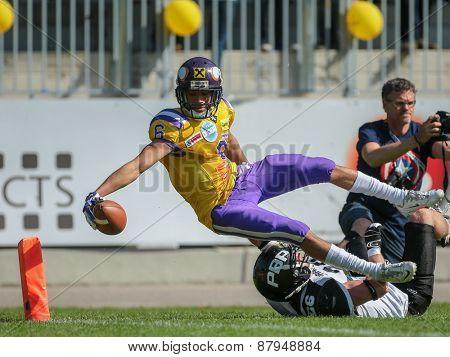 VIENNA, AUSTRIA - APRIL 27, 2014: WR Laurinho Walch (#6 Vikings) scores a touchdown.