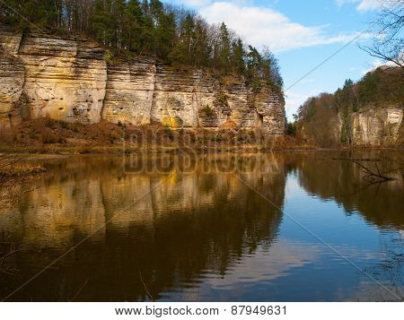 Sandstone rocks mirroring in the lake