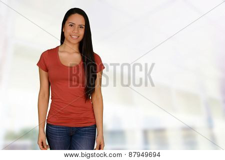 Casual young woman smiling at the camera