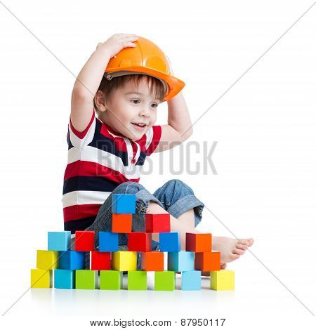 Kid Boy As A Construction Worker In Protective Helmet