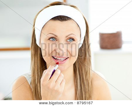 Pretty Young Woman Using A Red Lipstick In The Bathroom