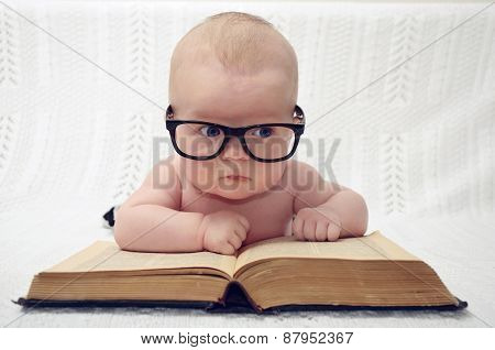 Cute Little Baby In Glasses