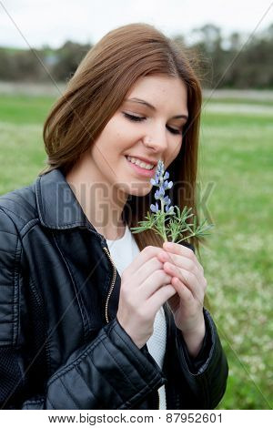 Portrait of a beautiful woman smelling a flower