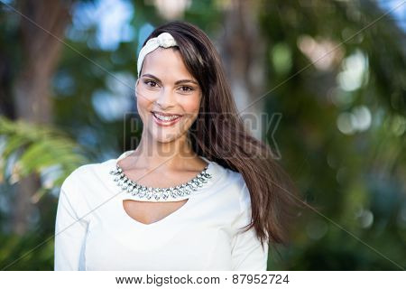 Beautiful woman smiling at camera outside