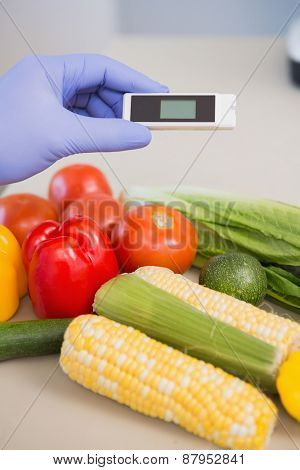 Scientist using device on vegetables in the laboratory