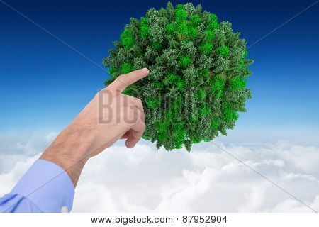 Hand of a businessman pointing something against blue sky over clouds