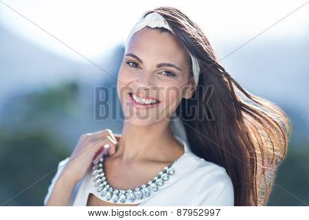 Gorgeous woman smiling at camera outside