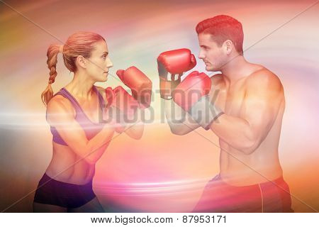 Boxing couple against purple and orange sky