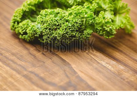 Curly parsley on wooden board shot in studio