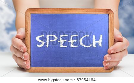 The word speech and hands showing chalkboard against bright blue sky with clouds