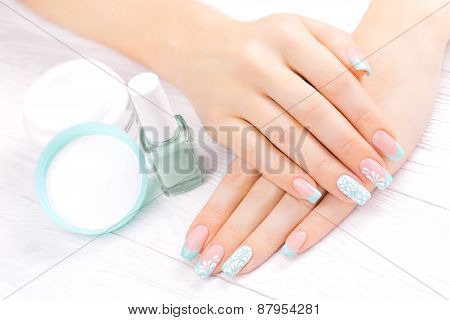 turquoise french manicure with light towel
