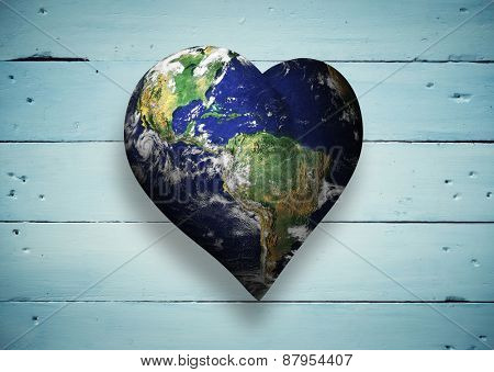 Heart shaped earth against painted blue wooden planks